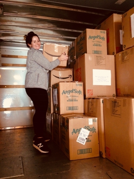 Photo: Lauren unloading the U-haul at the airport