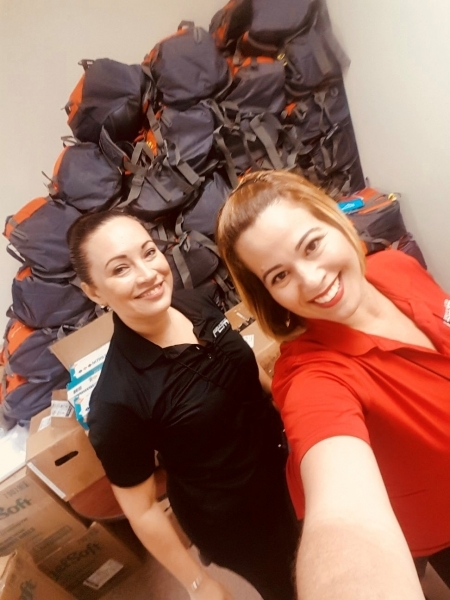 Photo: University of Puerto Rico staff with backpacks stacked at clinic